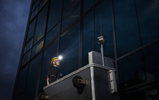 Building inspector lighting up a dark building with his V3pro Suprabeam headlamp
