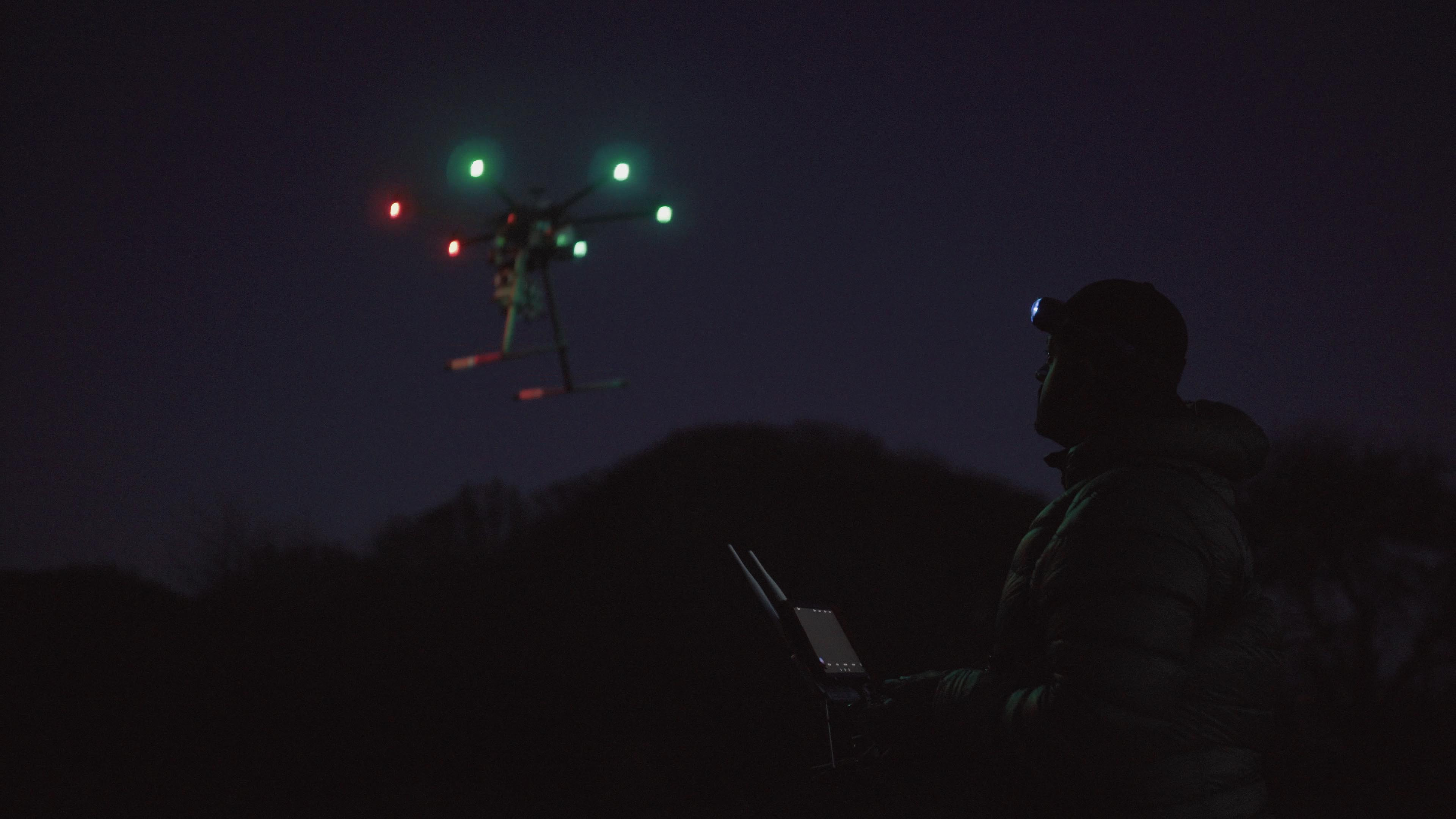 Professional drone pilot working on a dark morning with his S4 headlamp