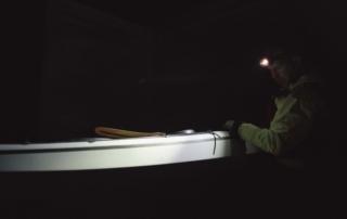 Kayaker sailing on a dark morning with his Suprabeam S3 headlamp