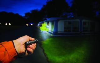 Suprabeam Q2 flashlight lighting up camping site