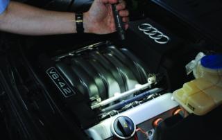 Inspecting Audi V8 engine with Suprabeam Q3 professional flashlight