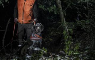 Professional schweiss dog handler using Suprabeam headlamp and flashlight