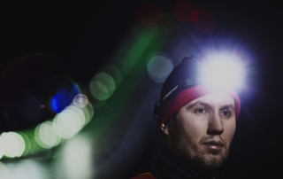 Professional cross country skiier with V3pro rechargeable headlamp