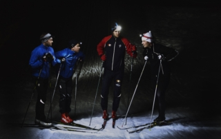 Cross country skiiers talking during evening training