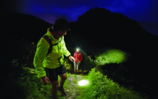 Hikers using their headlamps to navigate in the dark