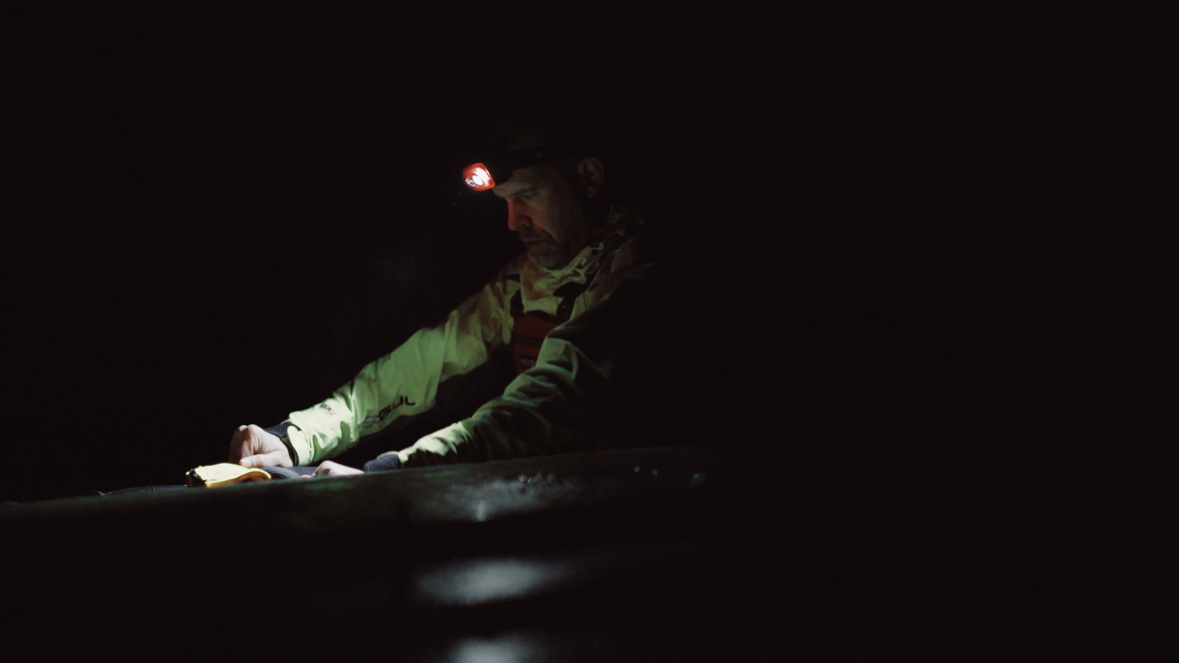 Kayaker sailing on a dark morning with his Suprabeam S3 headlamp