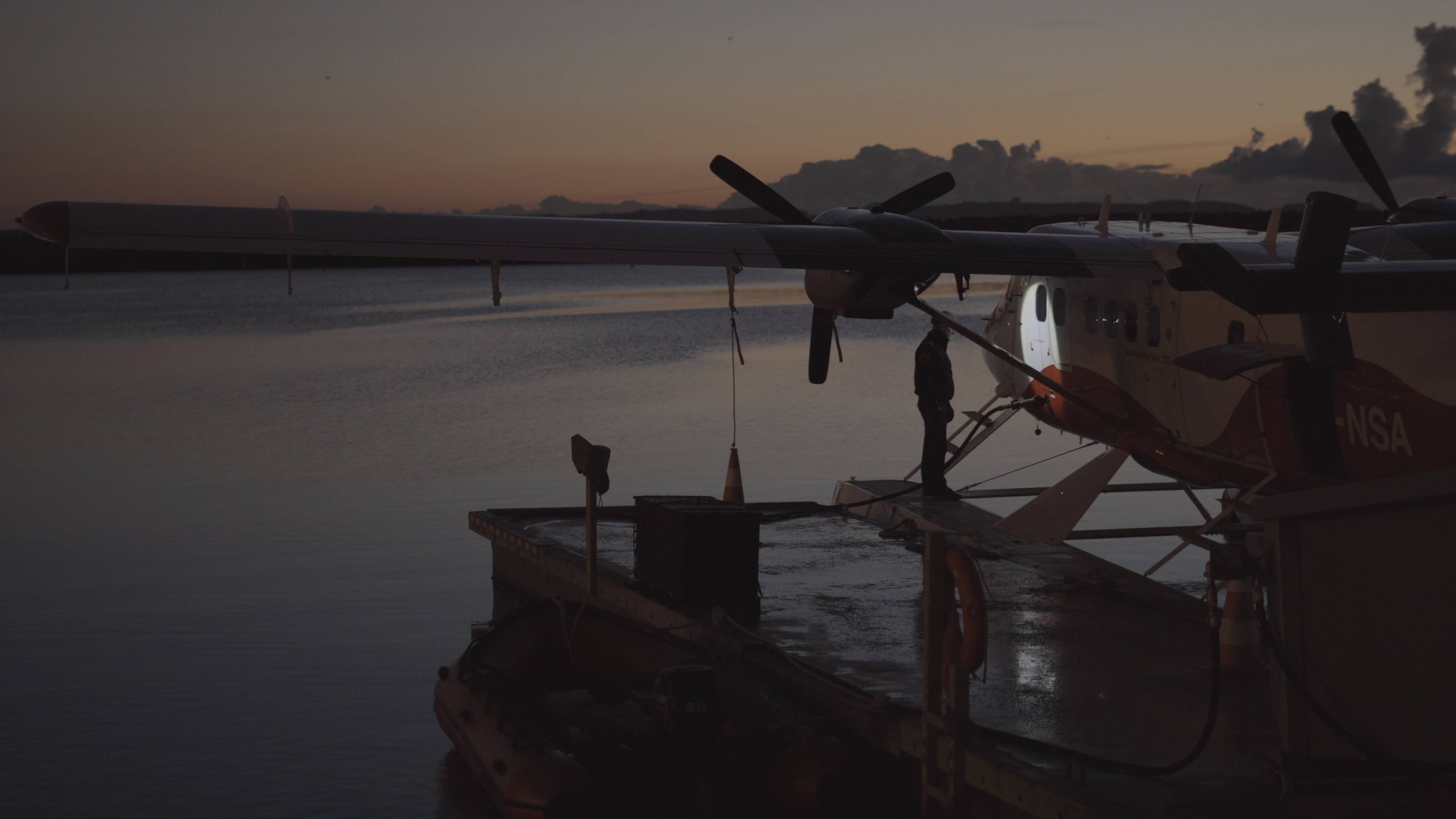 Flight mechanic inspecting seaplane before take off using the V3pro rechargeable headlamp